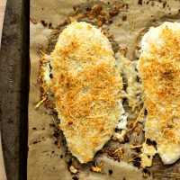 Healthy Parmesan Crusted Chicken - Chicken filets covered in Parmesan cheese and seasoned panko bread crumbs and baked until perfectly crispy. No frying required!