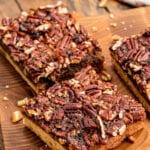 Cut pecan pie bars on board