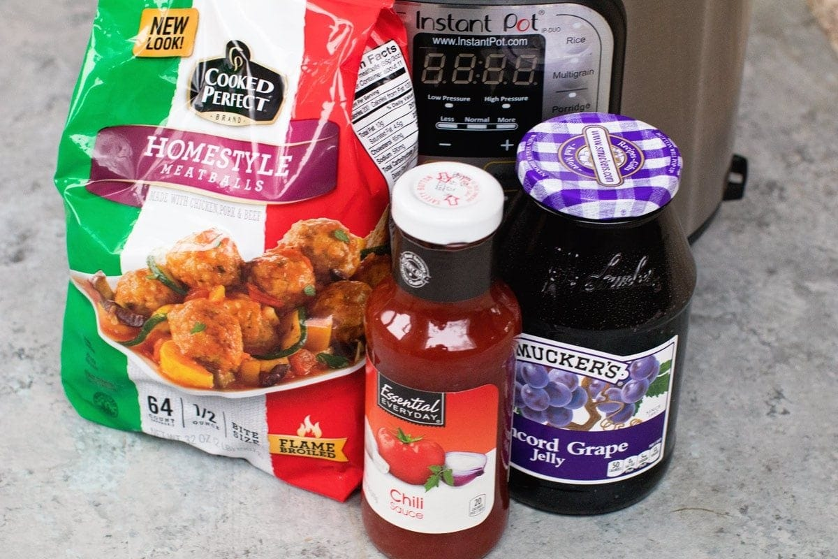 Ingredients to make grape jelly meatballs with Instant Pot in background