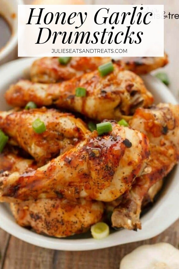 Honey garlic drumsticks in a white bowl