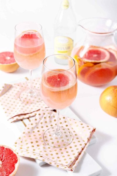 Celebrate seasonal produce by mixing this slightly sweet, yet delightfully tart Sparkling Grapefruit Sangria! Freshly squeezed pink grapefruit juice serves as the base of this cocktail, then a bottle of sauvignon blanc is added, along with Meyer lemon, blood orange and grapefruit slices. Chill before serving. Top individual glasses of sangria with Sprouts Farmers Market Sparkling Lemonade. Enjoy this sweet citrus goodness all winter long.