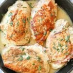 Four Chicken Breasts stuffed with Ham & Cheese in a lemon butter sauce in a cast iron skillet