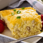 sausage and cheese hashbrown breakfast casserole slice on a white plate
