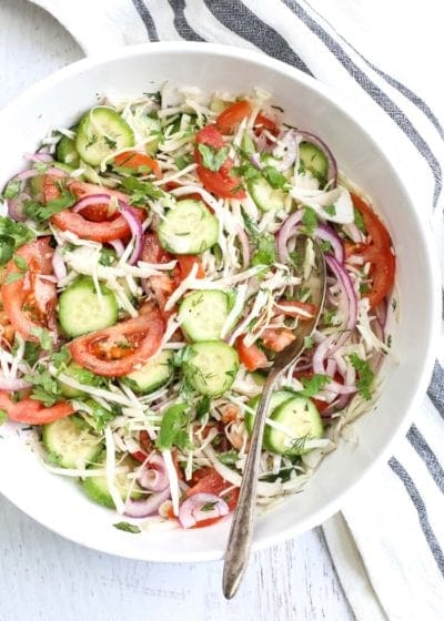 Cabbage, tomato, cucumber and onion salad with a light dressing.