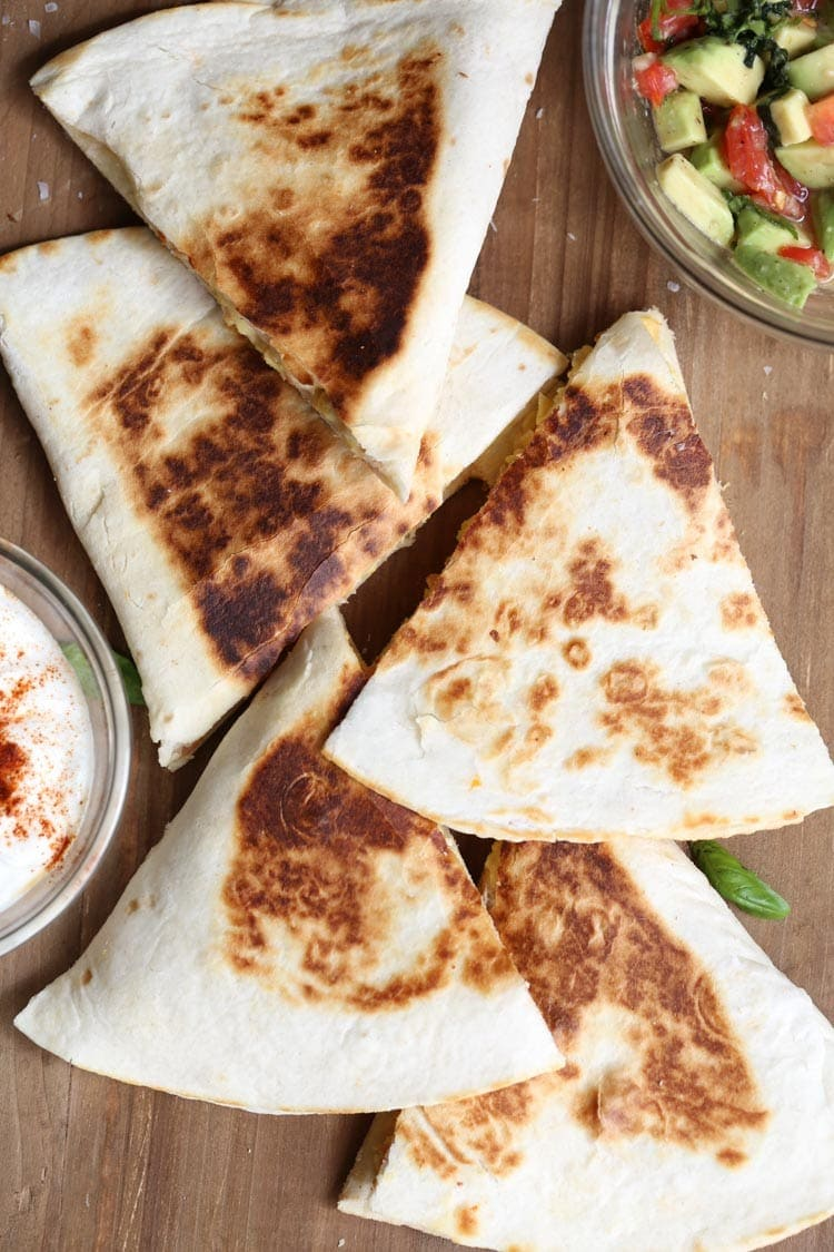 breakfast quesadillas on a board.