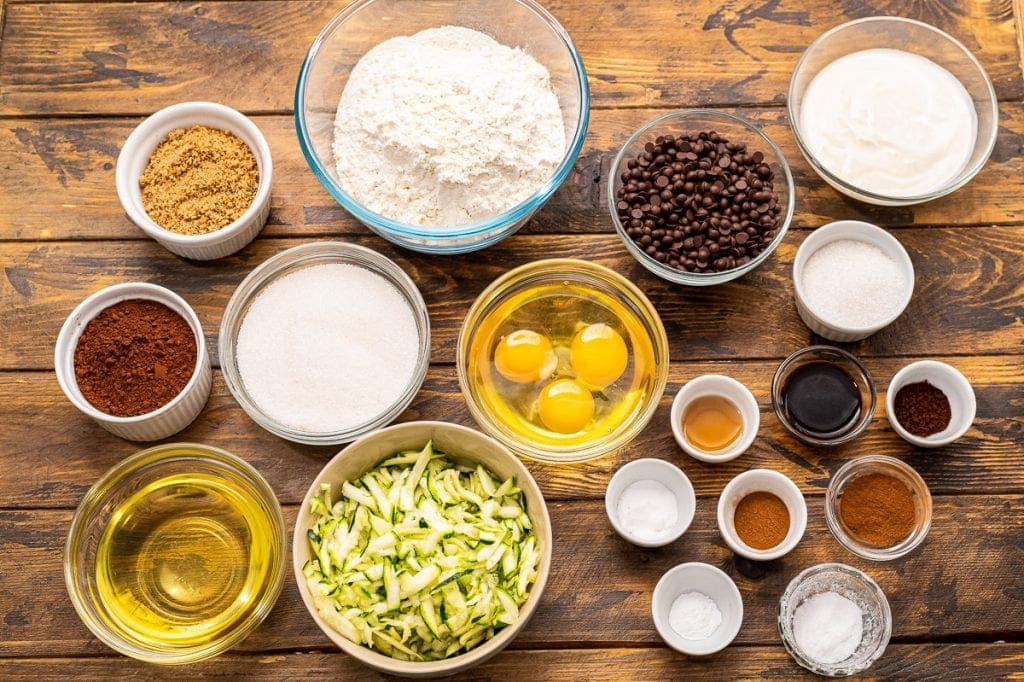 Overhead image showing ingredients in bowls for chocolate zucchini bread