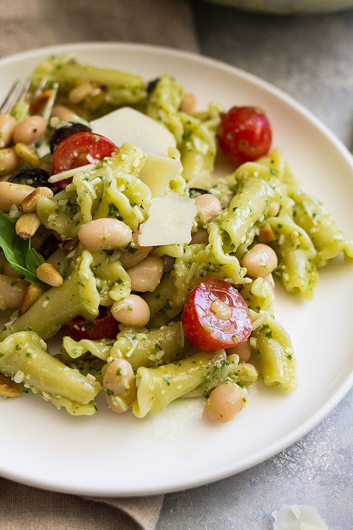 Closeup of Cold Pesto Pasta Salad on a plate.