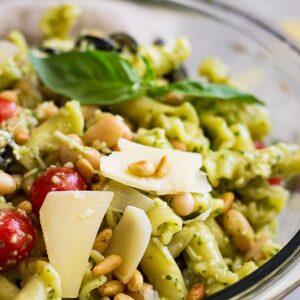 Close up of Italian Pesto Pasta Salad in a bowl.