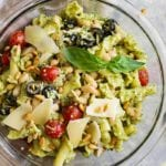 Top down view of Italian Pesto Pasta Salad in a glass bowl