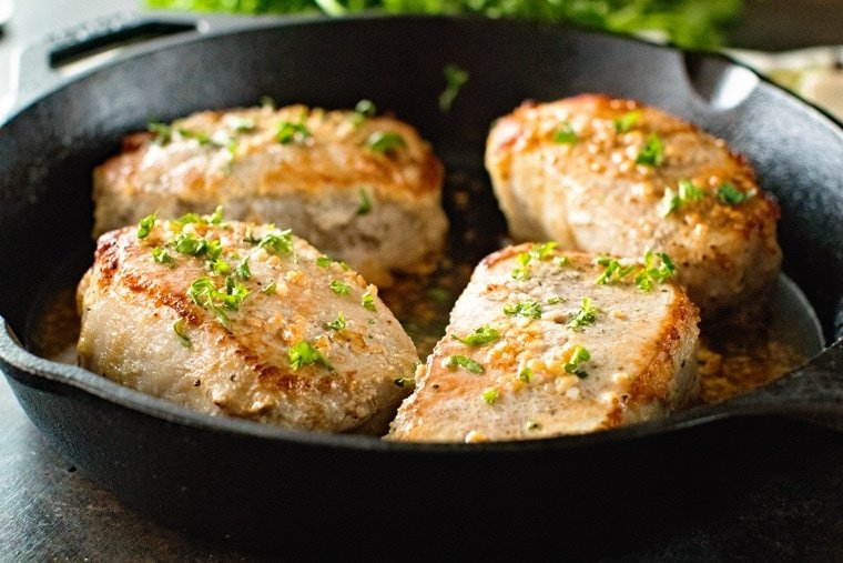 Baked Boneless Pork Chops in skillet