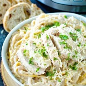 Pressure Cooker Chicken Alfredo in white bowl