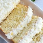 Lemon coconut cake sliced on a white tray