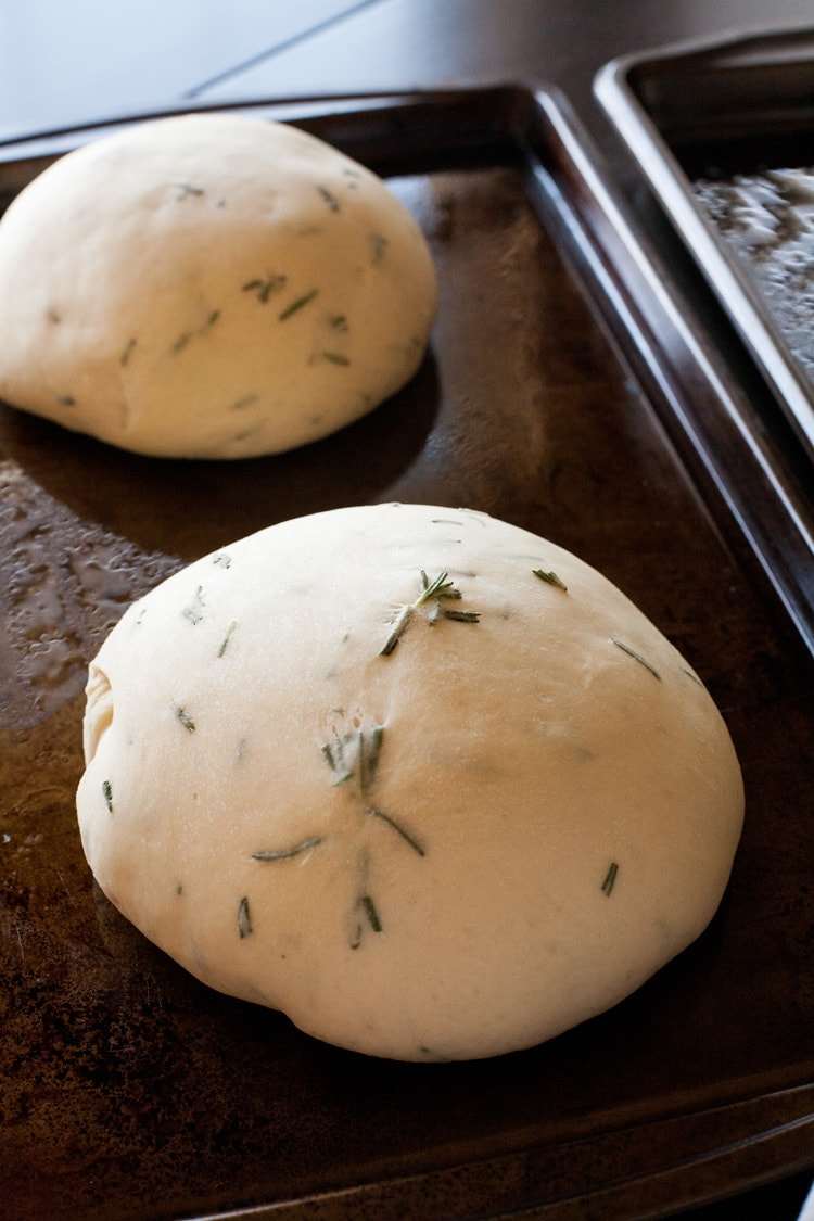 Close Up of rosemary bread dough on baking sheet