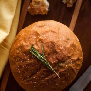 Rosemary bread loaf on a cutting board