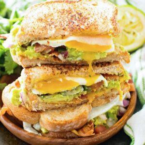 Southwestern Breakfast Sandwich Cut Open and stacked on a wood plate