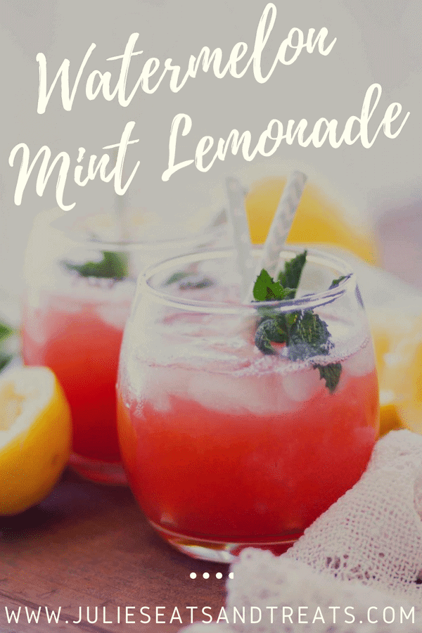 Watermelon mint lemonade in a short glass with a straw and mint