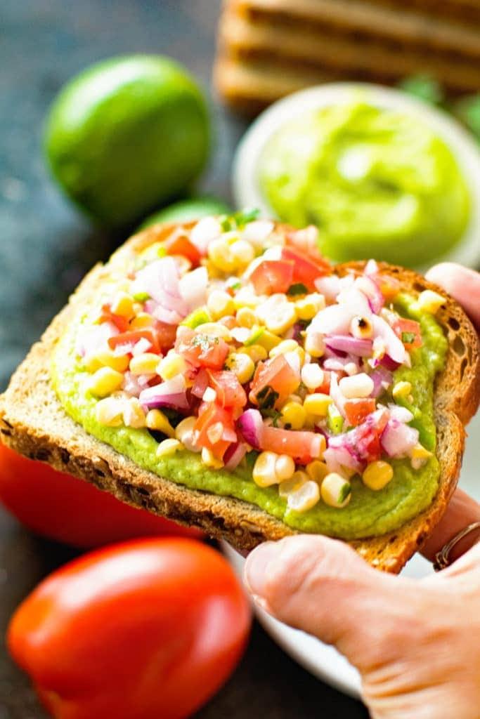 Hand holding Avocado Toast