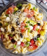 Pepperoni pasta salad in a glass mixing bowl