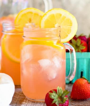 Vodka Strawberry Lemonade in Mug with lemon slices