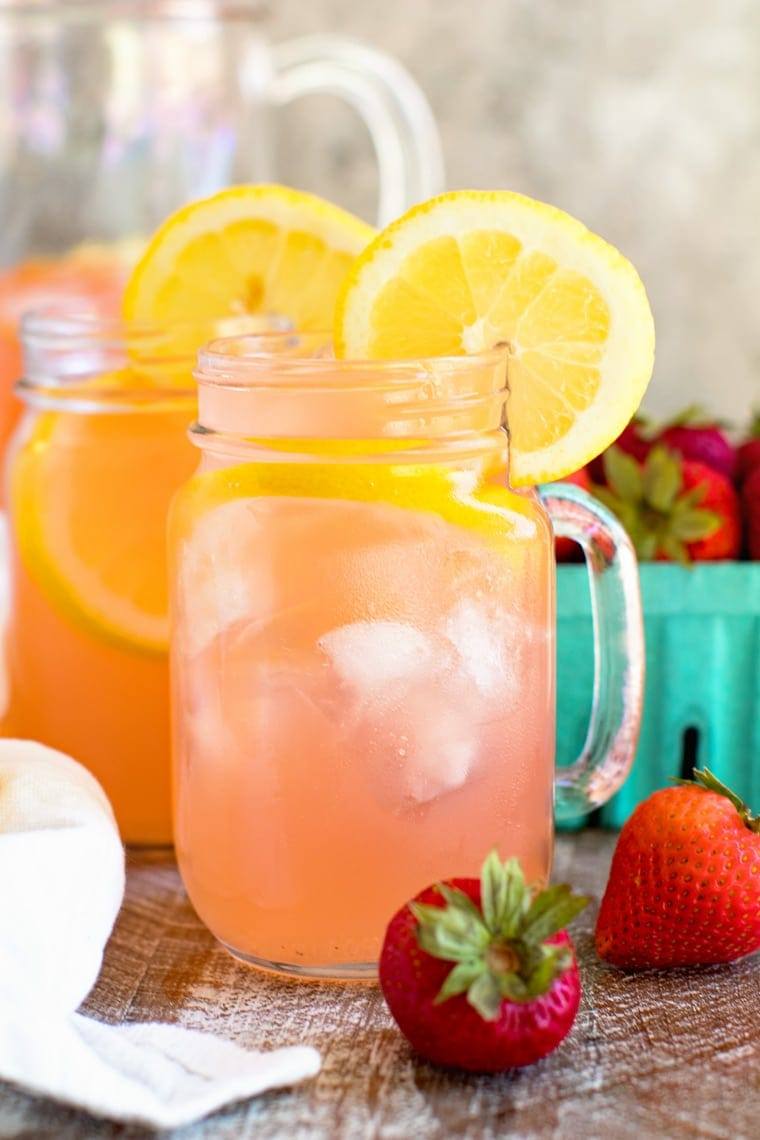 Vodka Strawberry Lemonade in Mason Jar Mug garnished with lemon slices