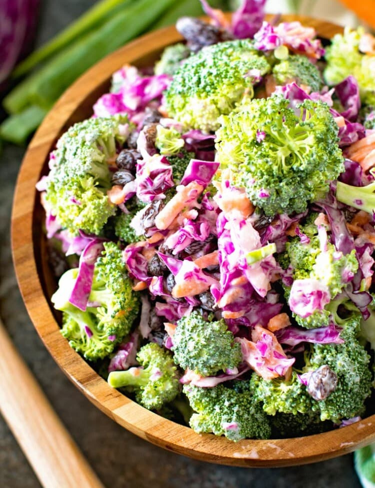 Light homemade broccoli slaw in brown bowl