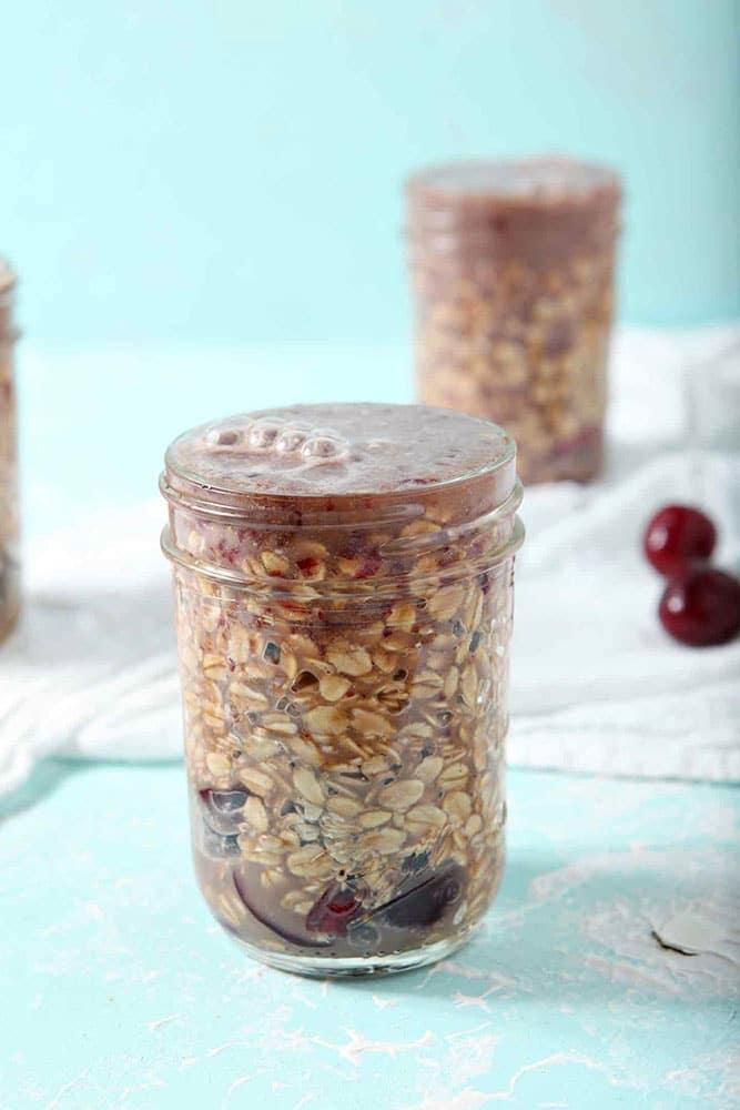 How to make Overnight Oats - Cherry Overnight Oats are filled to the brim and ready to chill in the refrigerator overnight