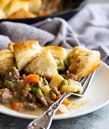Easy skillet beef pot pie on a white plate with a fork