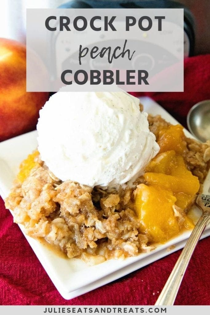 crock pot peach cobbler with vanilla ice cream on a plate