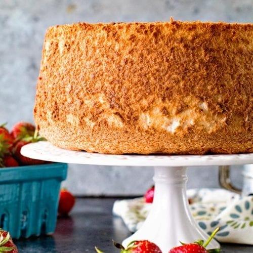 Homemade Angel Food Cake on white cake plate