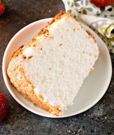 Slice of angel food cake on white plate