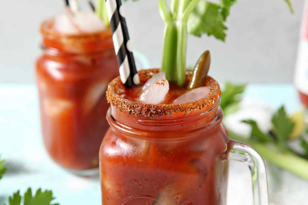 Two BBQ Bloody Marys sit next to each other on a light background