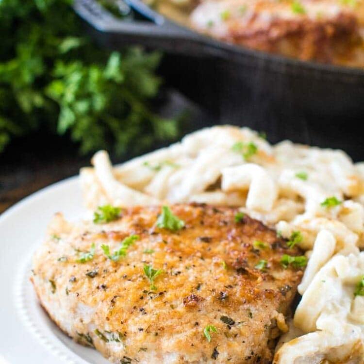Oven baked pork chops on white plate