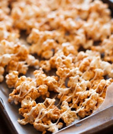 Butterscotch Popcorn drizzled with white chocolate on wax paper