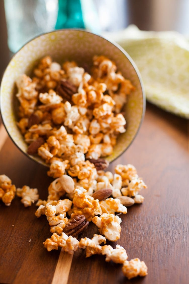 Whip up this super easy homemade popcorn with butterscotch for a yummy treat! Only two ingredients, and no baking!