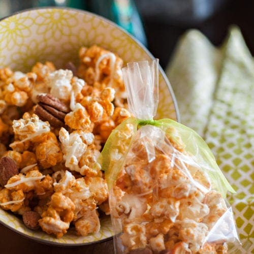 Butterscotch popcorn in a bowl and in a plastic bag