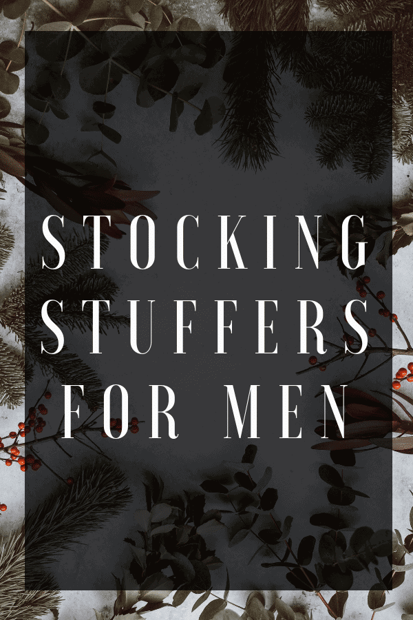 Text reading stocking stuffers for men with a background of tree branches