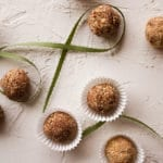 Balls of Almond Chocolate Meltaways on a white board.