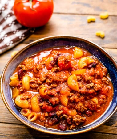 A bowl with cooked chili mac on it