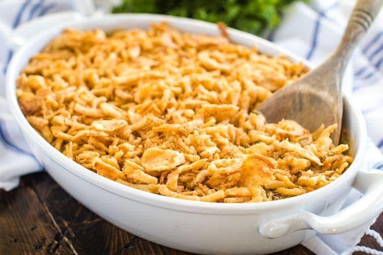 Green Bean Casserole Recipe in white baking dish with spoon