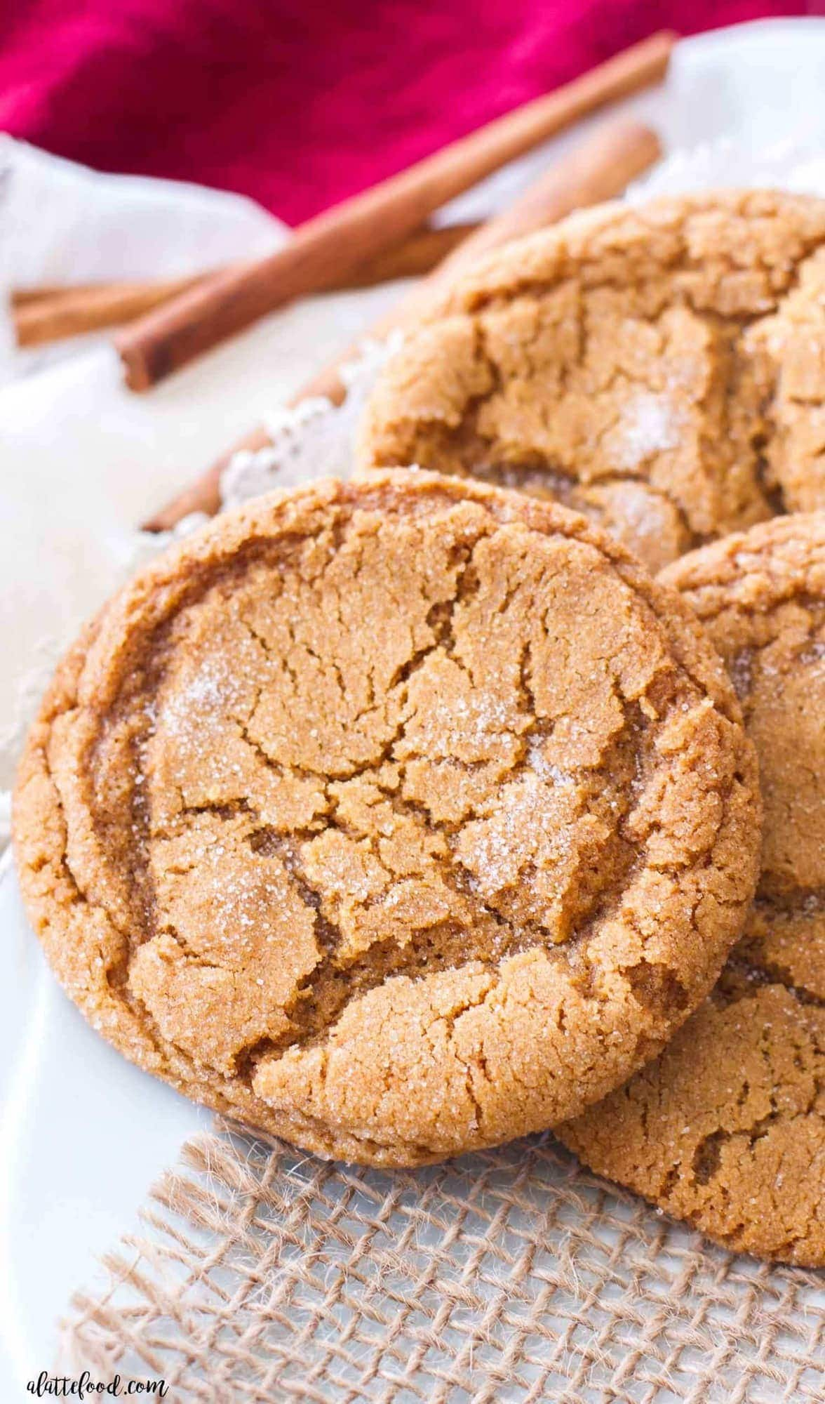 A plate of molasses cookies on a white plate.