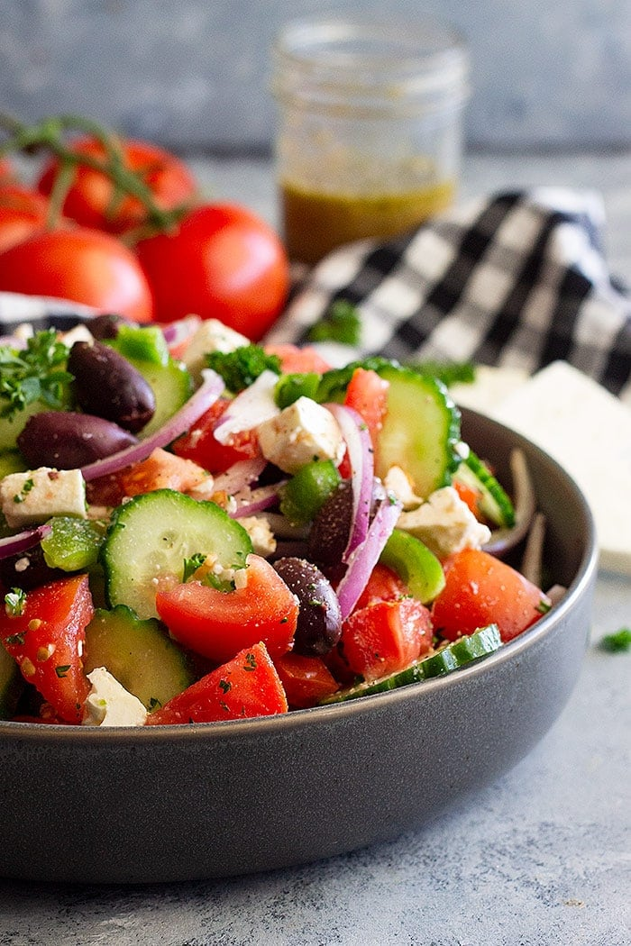 A gray bowl filled with Greek Salad Dressing Recipe.