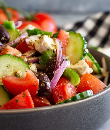 Chopped greek salad in a grey bowl