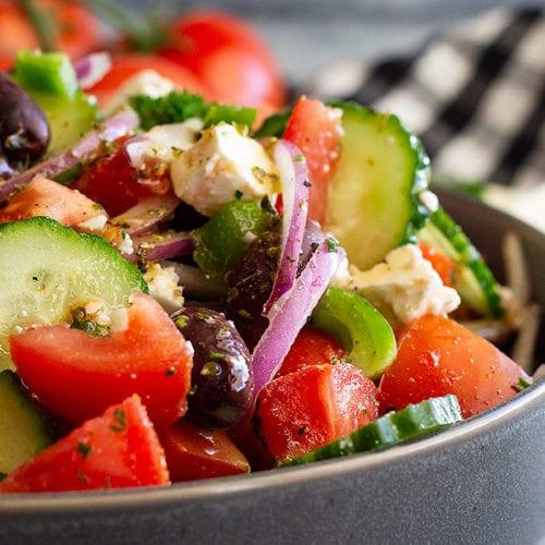 Chopped greek salad in a grey bowl