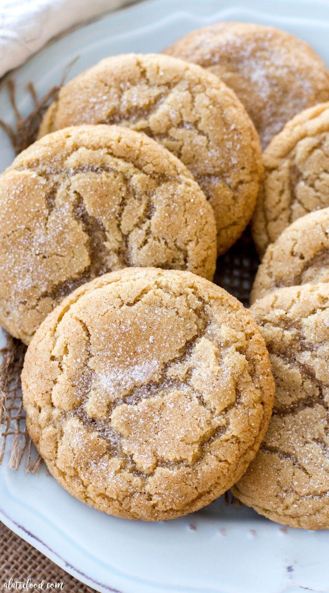 Snickerdoodle cookies on a green plate.