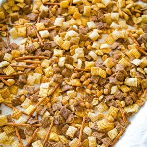 Chex Mix spread out on sheet pan