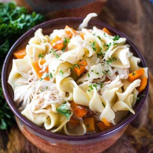 crockpot chicken noodle soup in brown bowl