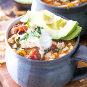 Taco Soup in bowl with sour cream and avocado