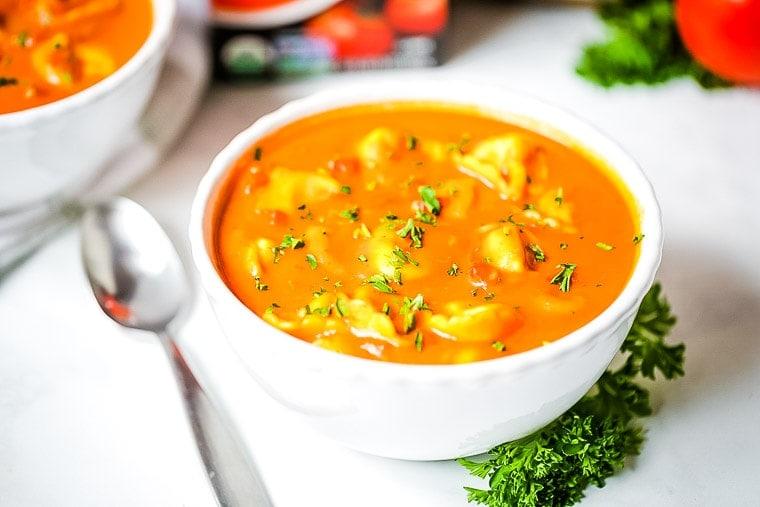 White bowl with tortellini tomato soup