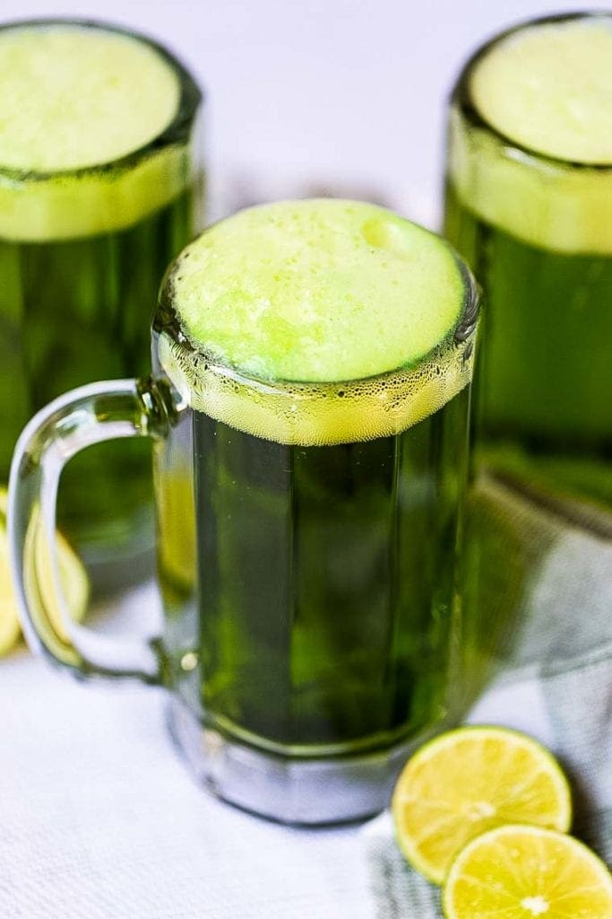Frothy Green Beer in Mug