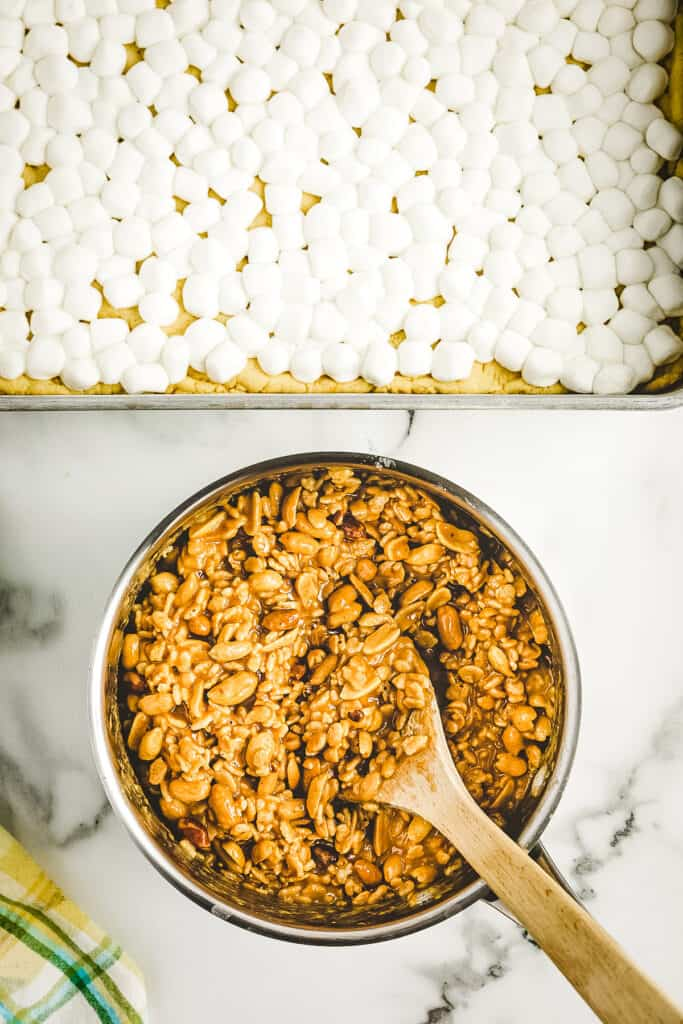 Overhead image of saucepan with melted peanut butter mixture and Rice Kripsies combined
